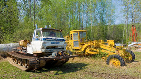 An old snow-cat and tractor on display at fort nelson, bc Stock Photo