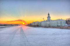 Old snow city. Neva river at sunset in San petersburg by the Kuntskamera museum Stock Photo
