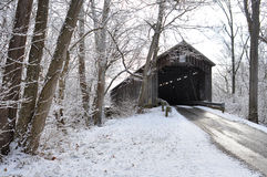 Old Snow Covered Wooden Bridge Stock Image