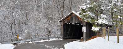 Old Snow Covered Wooden Bridge Royalty Free Stock Photography