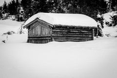 Old snowbound cabin Royalty Free Stock Images