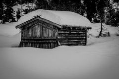 Old snowbound cabin Stock Images