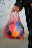 Old soccer bal in nylon bag Royalty Free Stock Images
