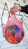 Old soccer bal in nylon bag Stock Photo