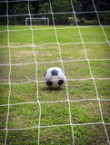 Old soccer ball on field Stock Photo