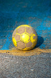 Old soccer ball. The old a soccer ball on the floor with a surface roughness Royalty Free Stock Images