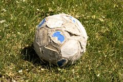Old soccer ball on the grass Stock Photography