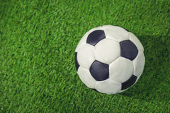 Old soccer ball. On a green background Royalty Free Stock Photo