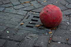 Old Soccer Ball in Gutter Royalty Free Stock Photography