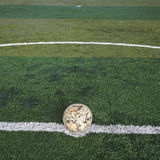 Old soccer ball on new Artificial turf Royalty Free Stock Image