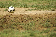 Old Soccer Ball. Poor school soccer field. Royalty Free Stock Image