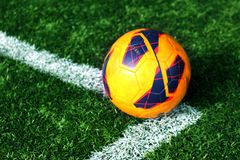 Old soccer ball on soccer field Stock Images