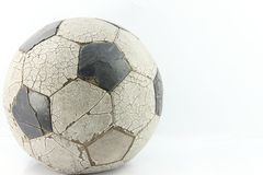 Old soccer ball on white Stock Photo