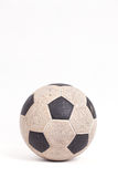 Old soccer ball. On white background Royalty Free Stock Photography