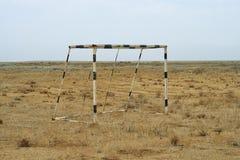Football goal in the desert. Stock Photos