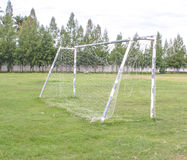 Old soccer goal in field with white cloud Stock Image