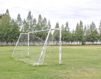Old soccer goal in field with white cloud Royalty Free Stock Photo