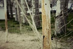 Old soccer goal. Rusty with an old web, on a close up scene in a amateur court Royalty Free Stock Photo