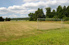Old soccer goal on the village sports field Stock Images