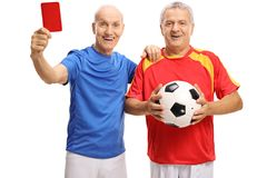 Old soccer players with a red card and a football. Isolated on white background Royalty Free Stock Image