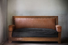 Old sofa. In grunge interior Royalty Free Stock Images