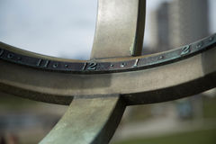 Old solar clock closeup. Concept time numbers eleven twelve one two Royalty Free Stock Images