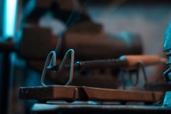 Old soldering iron in instrumental with blurred background. Stock Photography