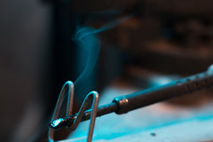 Old soldering iron in instrumental with blurred background. Royalty Free Stock Photography