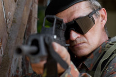 Old soldier with a gun Royalty Free Stock Photography