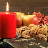 Old songbook and christmas decoration. Christmas decoration with old songbook and nuts royalty free stock photos