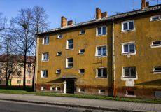 Old sorela houses damaged by vandalism in Czech Republic. Old houses built in simpler sorela style in Havirov, Czech Republic damaged by vandalism with cracked Stock Photo
