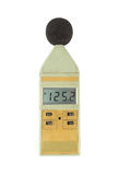 Old sound level meter (display show high level) on white. Background royalty free stock photography