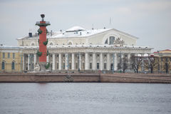 Old South Rostral column and the building of the St. Petersburg stock Exchange on the spit of Vasilyevsky island Royalty Free Stock Photo