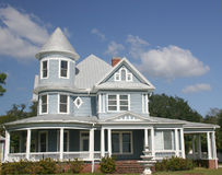 Old Southern Home. In tropics, blue with white trim, gabled and large circular front porch stock images