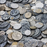 Old souvenir coins assorted close up background Royalty Free Stock Image