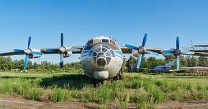 Old soviet aircraft An-12 at an abandoned aerodrome Stock Photos