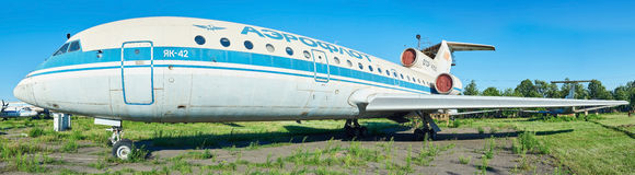 Old soviet aircraft YAK-42 at an abandoned aerodrome. Royalty Free Stock Images