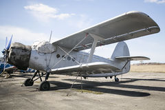 Old Soviet airplane. An-2 standing on airfield Stock Photo
