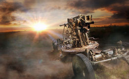 Old soviet  antiaircraft gun. Old  antiaircraft gun in cloud of dust in the open field Royalty Free Stock Image