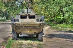 An old Soviet Armored troop-carrier. On the street (Hdr Stock Photos