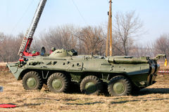 Old Soviet Armored troop-carrier. An old Soviet Armored troop-carrier on the street Armoured personnel carrier Stock Photo