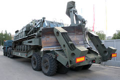 Old Soviet Armored troop-carrier. An old Soviet Armored troop-carrier on the street Armoured personnel carrier Stock Image