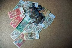 Old Soviet bills and coins on a gray table royalty free stock photo