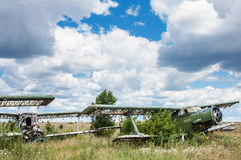 Old soviet biplane Antonov An-2 Colt aircrafts. On an abandoned airfield in Ukraine Royalty Free Stock Photography