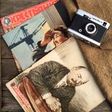 Old soviet camera & journals. Vintage soviet objects Royalty Free Stock Image