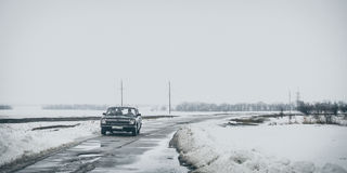 Old Soviet car on a country road Royalty Free Stock Image
