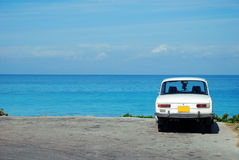 Old Soviet car by the ocean Stock Image