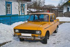 Old soviet car in village Stock Photography