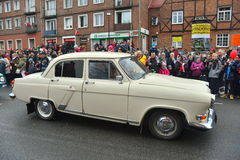 Old Soviet car Volga GAZ-21 on a street parade. Vintage beautifully restored Soviet Volga GAZ-21 on a street parade during Poland Independence Day on November Royalty Free Stock Images