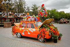 Old Soviet car Zaporozhets decorated with yellow leaves, flowers and things at festival `Moscow Autumn` in Novopushkinsky square i Stock Photos